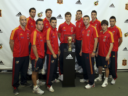 Members of the Spanish National Soccer Team Pose with their 2010 FIFA World Cup Trophy at an adidas event at WeGotSoccer