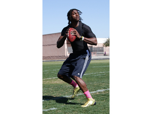 Image : Robert Griffin III working on his drop backs in the adizero 5-Star Mid