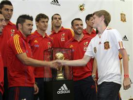 David Villa and the 2010 FIFA World Cup Champion Spanish National Soccer Team Welcome a Local Fan