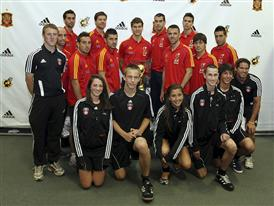 Members of the 2010 FIFA World Cup Champion Spanish National Soccer Team Pose with Local Youth Soccer Players