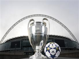 The adidas UCL Wembley Finale OMB on display with the UEFA Champions League trophy outside Wembley Stadium