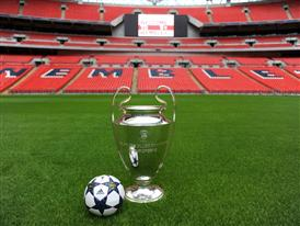 The adidas UCL Wembley Finale OMB on display with the UEFA Champions League trophy inside Wembley Stadium