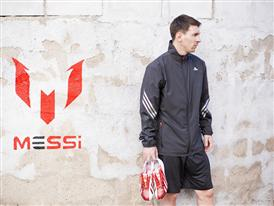 Leo Messi with the new adizero f50 Messi football boots
