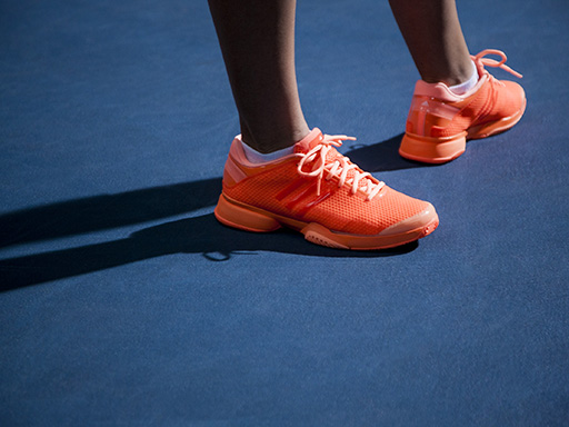 adidas presents the adidas by Stella McCartney barricade shoe in Pride Blue, White + Collegiate Navy and Warning Orange