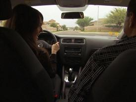 B-Roll of Parent Instructing Teen How to Drive