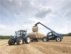 New Holland LM7.35 Telehandler loading bales in the field