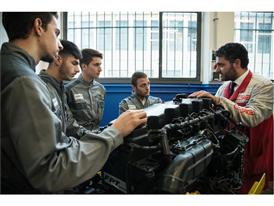 Students of the TechPro2 program learning about an FPT Industrial engine used for agricultural machinery