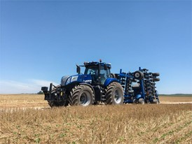 New Holland T8 NHDrive Autonomous Concept Tractor on the road with the New Holland 2085 Air Disc Drill in transport posi