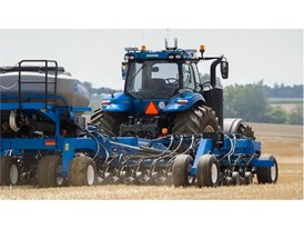 New Holland T8 NHDrive Autonomous Concept Tractor in the field with the New Holland 2085 Air Disc Drill Close Up