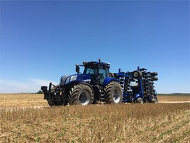 New Holland T8 NHDrive Autonomous Concept Tractor on the road with the 2085 Air Disc Drill in transport position