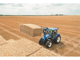 The T5 tractor range stacking bales in the field