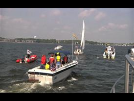Mark Rutherford and his boat Saint Brendan are met by a fleet of fans and well-wishers as he sails into Annapolis