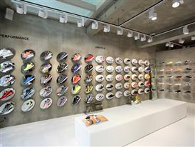 Shoes line the walls of FILA's new 3-story mega shop in Itaewon, Seoul