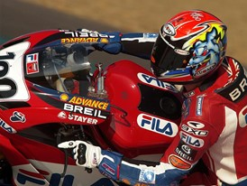 A member of the Ducati Superbike Team on the FILA-emblazoned motorbike