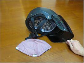 Nonwoven protective cushion in the helmet