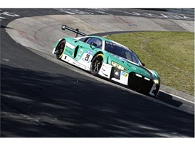 The Land Motorsport Audi charges through the Karussel banking