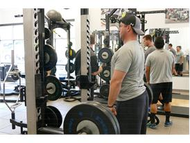 Pit crew team member lifts weights