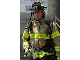 JJ Watt in firefighter equipment