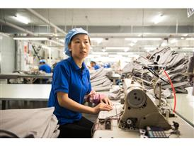 Jinmin Tang works in stitching factory Hilong Dongtai