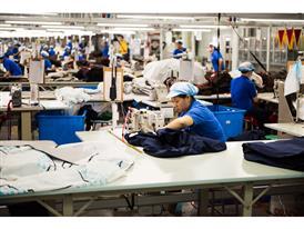 Xiaomei Gu works in the stitching factory Hilong Dongtai