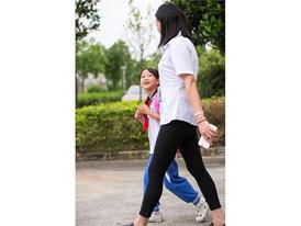 Xiaohong Lin, who works in MYS Dongguan, and her daughter Yike Yang