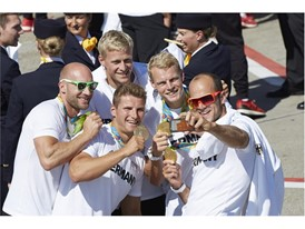 German Olympic Team members celebrating after arrival in Frankfurt