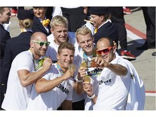 German Olympic Team members celebrating after arrival in Frankfurt