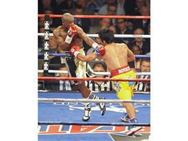 Mayweather attempts a dodge 3099
