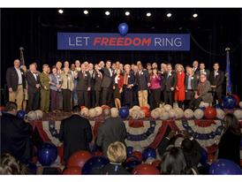 Dignitaries onstage under slogan for 2016 Presidential Debate in Las Vegas