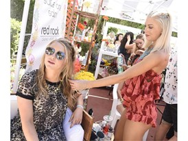 Partygoers get styled at pop-up braid bar at the #WHHSH Las Vegas Party in Palm Springs