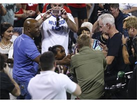 Mike Tyson greets John McEnroe