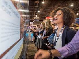 Trade show attendee experiences new technology