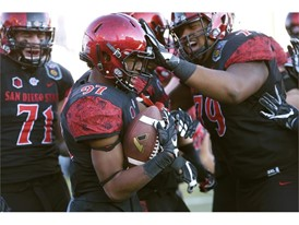 San Diego State wide receiver Curtis Anderson III and teammates celebrate