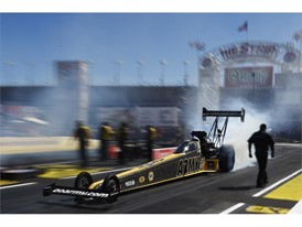 Tony Schumacher smokes his tires