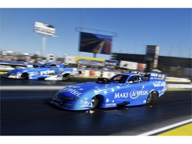 Funny Car drivers Tommy Johnson Jr., right, beats John Force