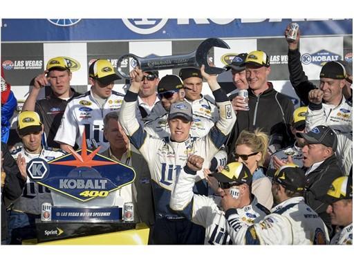 Brad Keselowski raises Kobalt 400 trophy