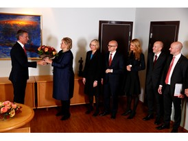 The new Norwegian Prime Minister, Ms Erna Solberg, receives flowers from former PM Mr Jens Stoltenberg.