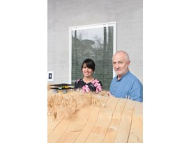 "Mentor Peter Zumthor and protégée Gloria Cabral, in Haldenstein, with a model for Zumthor's design of a South Korean ""te"