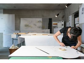 Protégée Gloria Cabral working with a cardboard model in mentor Peter Zumthor's studio in Haldenstein.
