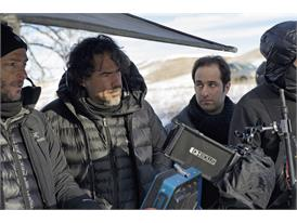 Mentor Alejandro González Iñárritu (second from left) and protégé Tom Shoval (second from right) during filming in Alber