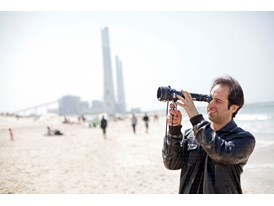 Protégé Tom Shoval scouts for locations for his next feature film at Sdot Yam beach.