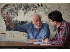 Mentor Michael Ondaatje (left) and protégé Miroslav Penkov discuss Penkov's manuscript for his novel.