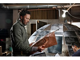 At the Cooperative Moussaouia, an artists' workshop in Marrakech, protégé Sammy Baloji prepares a copper panel that will