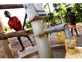 Boys Fill Up their Jerrycans at a Borehole Donated by the Rotary Club of Muyenga