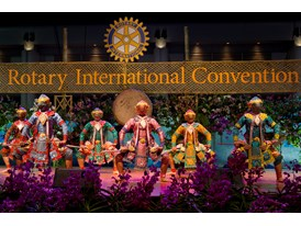 Performers help celebrate the opening of Rotary International's House of Friendship