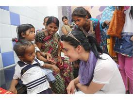 Actress and Rotary polio ambassador Archie Panjabi immunizes a child against polio in New Delhi, India