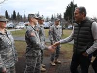 B-roll of Howard Schultz with active duty military members