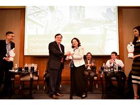 Organizer presenting prize to Patrick Teng at the ACCA Debate 2015