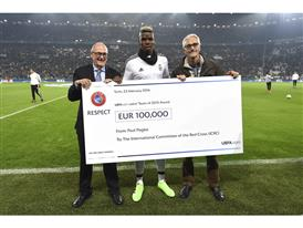 UEFA Executive Committee member, Fair Play and Social Responsibility Chairman Peter Gilliéron, handed the cheque