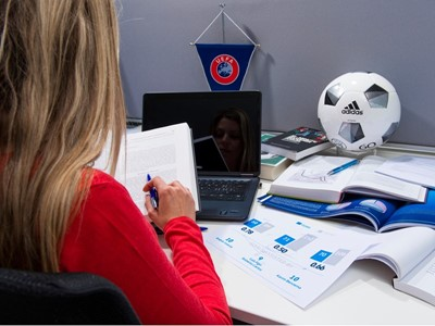 Why does UEFA invest in education?